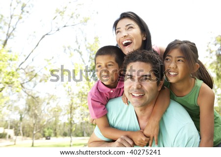 Young Family In Park