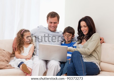 Young family surfing the internet together