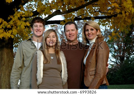 young family with two teen children