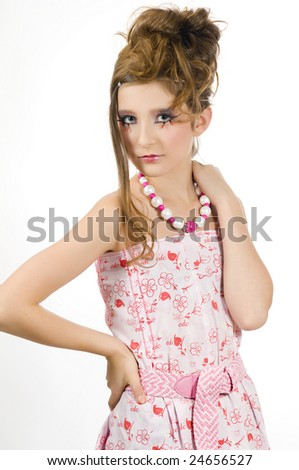 Young fashion girl with special eye makeup showing jewelry and pink white clothes