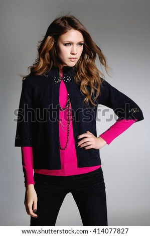young fashion model posing on gray background