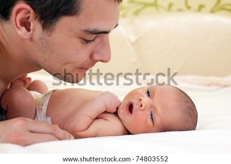 Young father and newborn baby boy