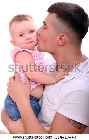 Young father kissing his little baby