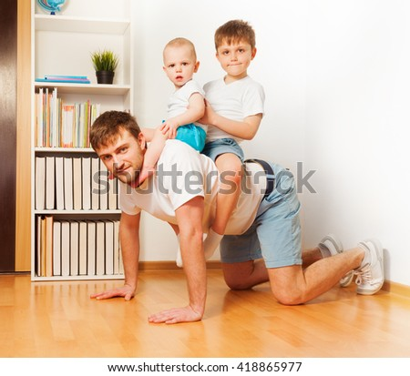 Young father playing with his two sons