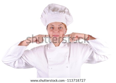 young female executive chef point her cheek, isolated on white