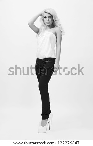 young female fashion model,posing at white background,black and white shot
