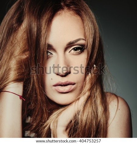 Young female posing with expression in studio. Beauty and fashion.