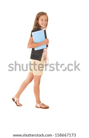 Young female student walking with school  book