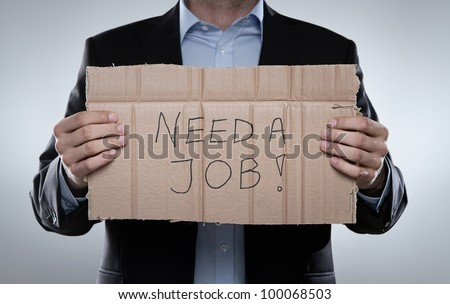 Young fired businessman looking for a job
