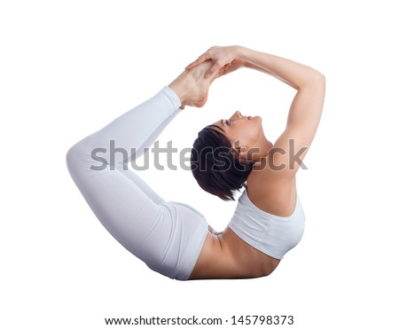 Young flexible woman doing yoga in studio