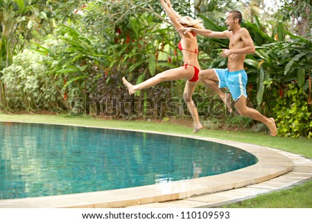 Attractive woman under tropical rain exotic stock photo for Tropical vacations for couples