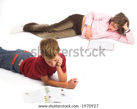 Young girl and boy reading book