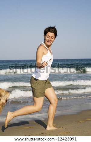 Young girl and dog playing