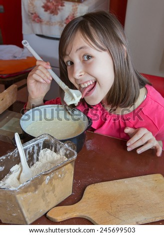 young girl gustation at the cooking