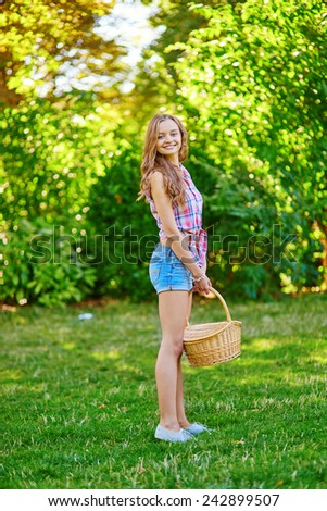 Young girl holding a picnic basket