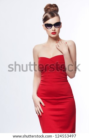 Young girl in a red dress on a white background