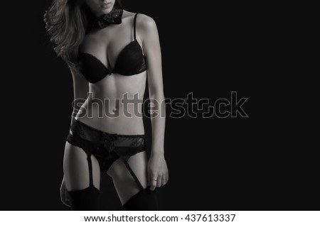 Young girl in black underwear. Isolated on black.