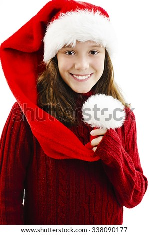 Young girl in red Santa hat. Isolated on white background