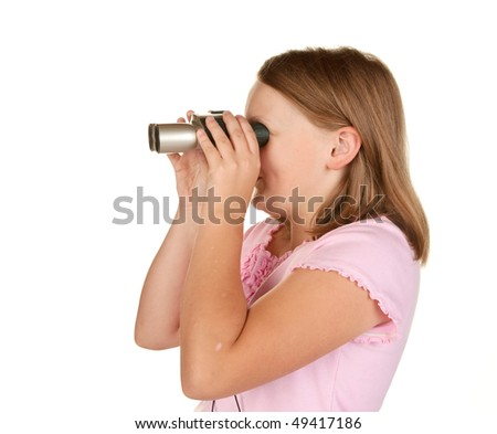 young girl looking through binoculars on white