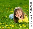 young girl on the grass - stock photo