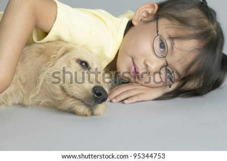 Young girl relaxing with dog