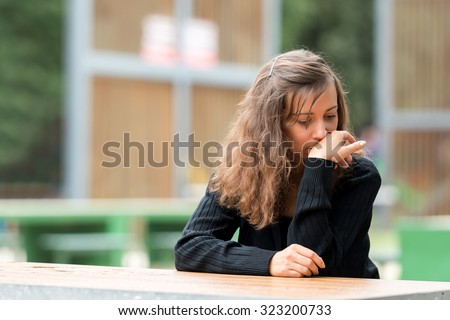 Young girl resting and regretting the made decision.