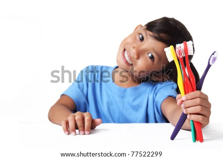 young girl showing a bunch of toothbrush