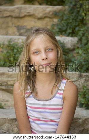 stock-photo-young-girl-smiles-sitting-on-an-outdoor-steps-147644153 How come Dating A Polish Woman So Eye-catching?
