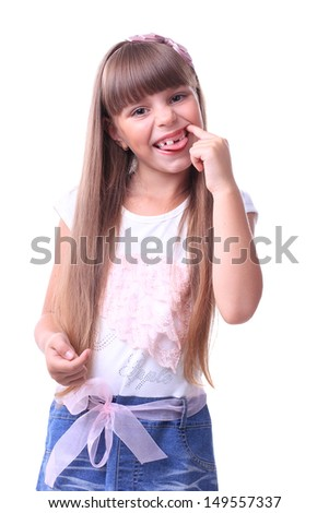 Young girl smiles without teeth