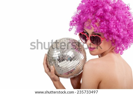 young girl with a pink wig and glasess holding a disco ball