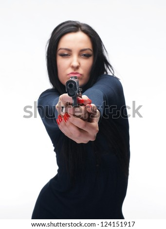 Young girl with a pistol on white background