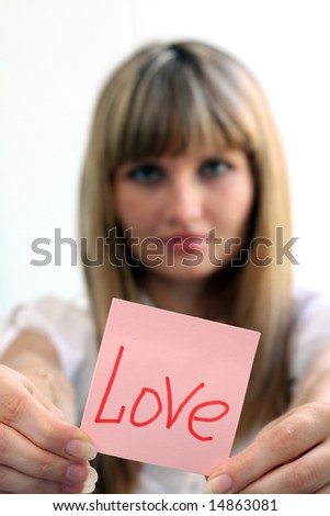 Young girl with love message on note pad