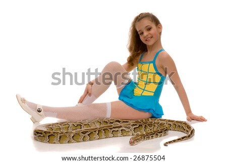 young girl with royal python snake lying by her feet, isolated on white background