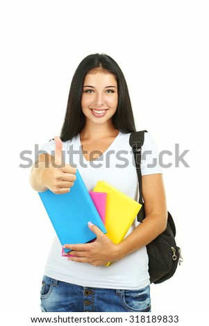 Young girl with school backpack holding books