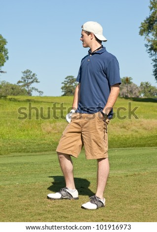 Young golfer assessing distance on fairway to determine correct golf club
