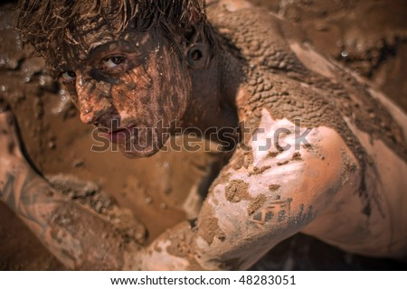 young guy full with mud