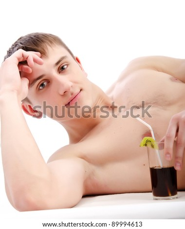young guy lie with glass in hand, isolated over white