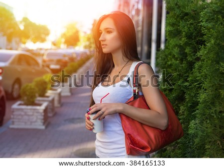Young happy caucasian woman enjoy coffee in morning city park outdoor. Relax lifestyle summer concept