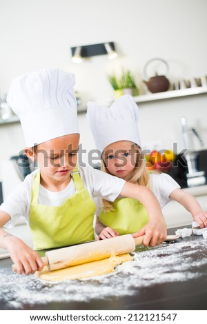 young happy children kids family preparing funny cake in kitchen at home
