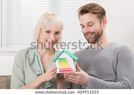 Closeup person detecting heat loss outside stock photo 519787972 shutterstock - House plans for young couples energetic designs ...