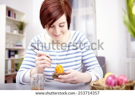 Portrait happy young girl tablet computer stock photo 253714438 young happy girl with brush and easter eggs for easter holiday negle Images