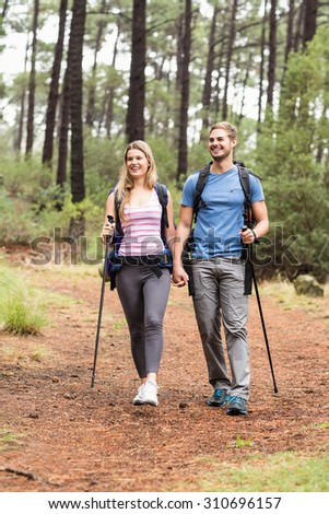 Young happy hiker couple hiking in the nature