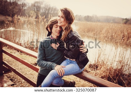 young happy loving couple on the walk in early spring on riverside, casual lifestyle series
