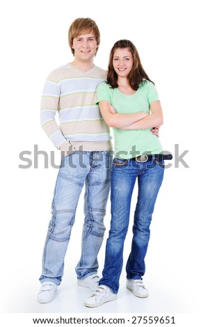 young happy loving couple standing together - isolated on white background