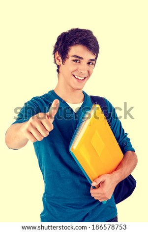Young happy student showing thumbs up over white background
