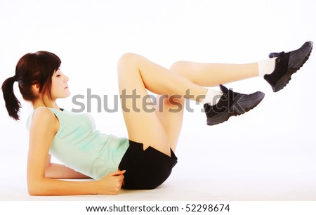 Young happy woman doing fitness