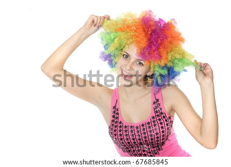 young happy woman in clownish wig over white