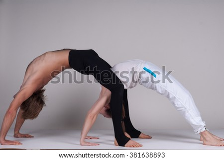 cute little girl doing gymnastics exercise stock photo