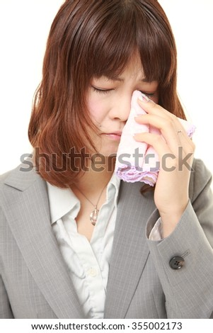 young Japanese businesswoman cries