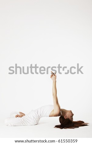 young lady practicing sideways crow yoga stock photo